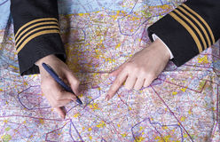 Airline officer planning a route Stock Photos