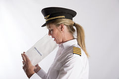 Airline officer using an air sickness bag Stock Photo
