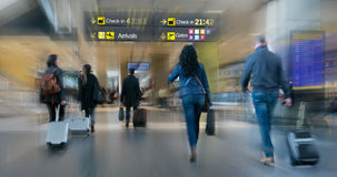 Airline Passengers inside an Airport. Royalty Free Stock Photo