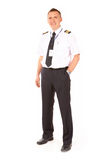 Airline pilot. Cheerful pilot wearing uniform with epaulets, standing isolated on white background. When flying for an commercial airline, pilots are usually royalty free stock images