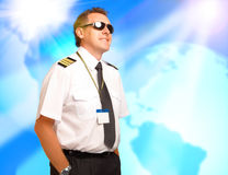 Airline pilot. Wearing uniform with epaulettes royalty free stock image