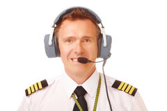 Airline pilot. Wearing uniform with epaulettes and professional headset stock photo