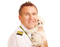 Airline pilot with dog Stock Images
