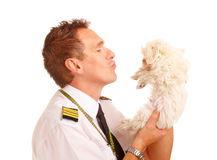 Airline pilot with dog Royalty Free Stock Image
