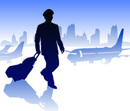 Airline pilot with luggage in airport against city Royalty Free Stock Photo