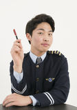 Airline pilot with pen Royalty Free Stock Photos