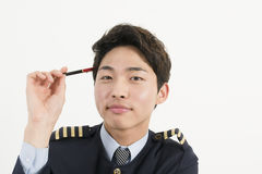 Airline pilot with pen Royalty Free Stock Photo