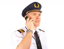 Airline pilot on the phone Royalty Free Stock Image