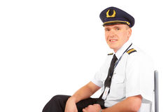 Airline pilot sitting Stock Image