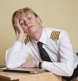 Airline pilot sleeping Royalty Free Stock Photography
