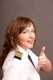 Airline pilot thumb up Royalty Free Stock Photography