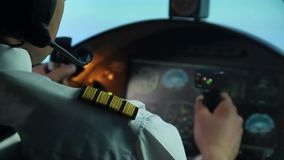 Airline pilot trying to prevent accident, plane shaking in turbulence, danger. Stock footage stock video footage