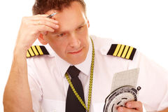 Airline pilot using flight computer Royalty Free Stock Images
