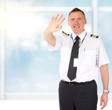 Airline pilot waving Stock Photo