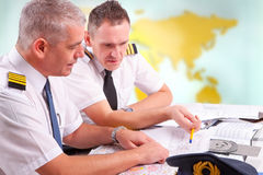 Airline pilots filling in papers in ARO Stock Image