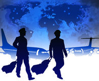Airline pilots with luggage in airport Royalty Free Stock Image