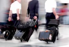 Airline Pilots in Motion Stock Images