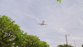 Airline Planes Landing aircraft approaching. Airline Planes Landing aircraft approach at the airport slow motion long lens Boeing 737 Airbus A320 afternoon clear stock footage