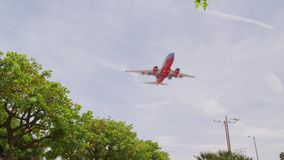 Airline Planes Landing aircraft approaching. Airline Planes Landing aircraft approach at the airport slow motion long lens Boeing 737 Airbus A320 afternoon clear stock video