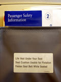 Airline-Seat Pocket Info. This photo was taken inside a commercial airliner. This shows the Safety Information brochures and barf bag in the seat pocket behind stock photos