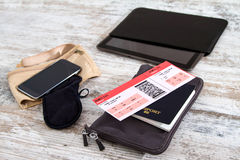 Airline ticket, passport and electronics Stock Photo