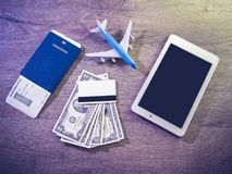 Airline ticket, passport and electronics, preparing to travel.  Royalty Free Stock Images