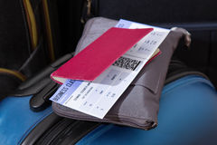 Airline ticket, passport and luggage Stock Image