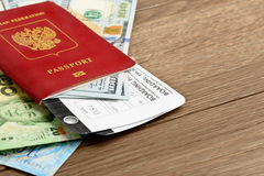 Airline tickets and documents. On wooden table Royalty Free Stock Photography