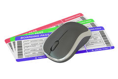 Airline tickets and mouse - Online booking concept Royalty Free Stock Photos