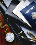 Airline tickets and passport. Airline tickets with passport on a desk Stock Photo