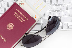 Airline tickets and travel passport. Of german over comuter keyboard Stock Images