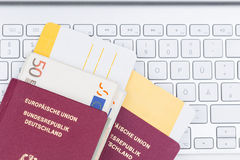 Airline tickets and travel passport. Of german over comuter keyboard Royalty Free Stock Images