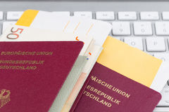 Airline tickets and travel passport. Of german over comuter keyboard Stock Photo