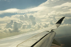 Airline wing over the clouds Royalty Free Stock Photos