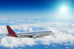 Airliner. Is flying on clouds Stock Photography