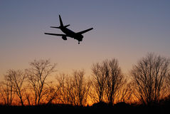Airliner. Landing against beautiful sunrise Stock Photos