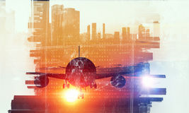 Airliner above business center. Double exposure of airplane and moden cityscape royalty free stock images