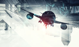 Airliner above business center. Double exposure of airplane and moden cityscape stock images