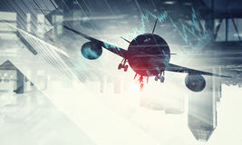 Airliner above business center. Double exposure of airplane and moden cityscape royalty free stock photo