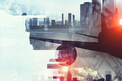 Airliner above business center. Double exposure of airplane and moden cityscape royalty free stock photography