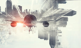 Airliner above business center. Double exposure of airplane and moden cityscape royalty free stock image