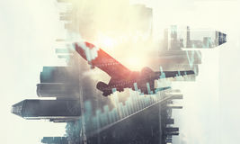 Airliner above business center. Double exposure of airplane and moden cityscape stock photography