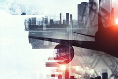 Airliner above business center . Mixed media. Double exposure of airplane and moden cityscape royalty free stock images
