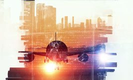 Airliner above business center . Mixed media. Double exposure of airplane and moden cityscape Stock Images