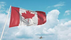 Airliner approaches the Canadian flag. Tourism in Canada