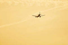Airliner approaching airport for landing Stock Images