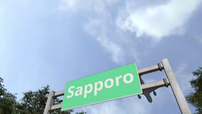 Airliner arrives in Sapporo, Japan. 3D animation. Airliner landing in the city. 3D stock video