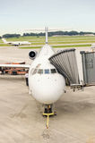 Airliner Being Serviced While Another Takes Off Royalty Free Stock Images
