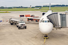 Airliner Being Serviced Between Flights White Another Lands Royalty Free Stock Images