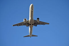 Airliner and blue sky Stock Photography